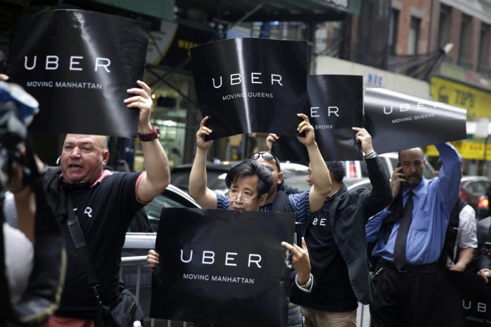 London tribunal rules Uber drivers deserve workers' rights