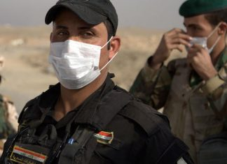 Toxic fumes from sulphur phosphates plant burns in Iraq Mosul