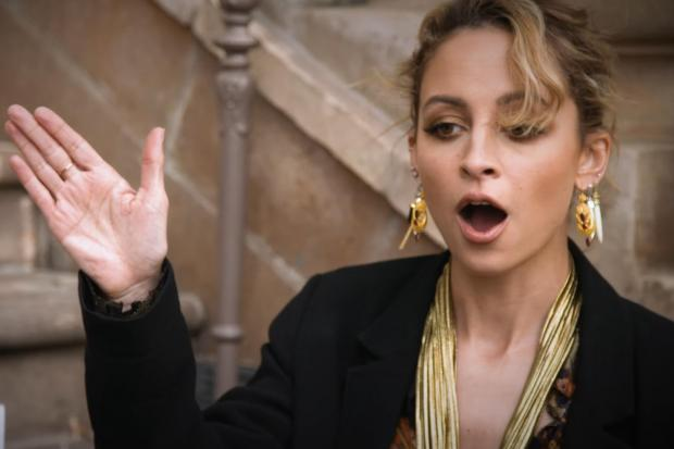 Nicole Richie smacked in face when high-five goes wrong during awkward interview