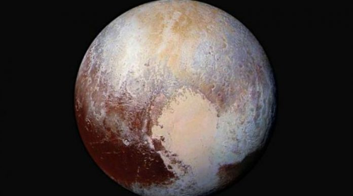 NASA research reveals liquid water below icy surface of Pluto