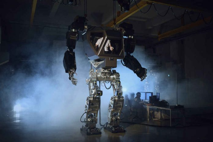 13ft tall manned robot learns to walk and move hands (Watch)