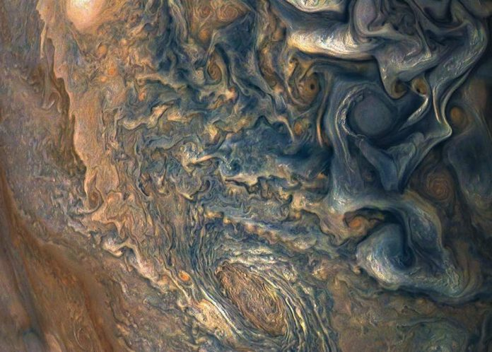 Watch: Nasa captures turbulent Jovian clouds in stunning new photo