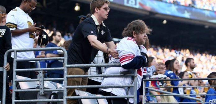Giants fan: Saints Fan Helping Disabled Fan Stand (Picture)