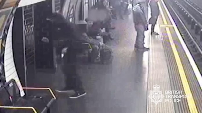 Paul Crossley pushes Robert Malpas onto London Underground tracks
